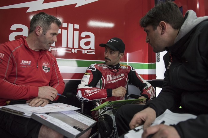 Laverty in discussion with crew chief Phil Marron and an Aprilia employee who more than likely can't understand a word
