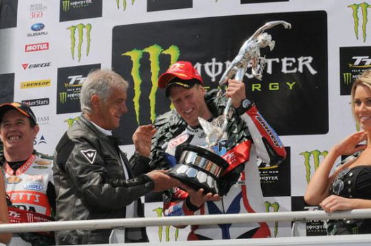 Johnson receives his first trophy from Giacomo Agostini