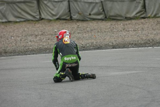 Rutter gets up from his spill at the Hairpin