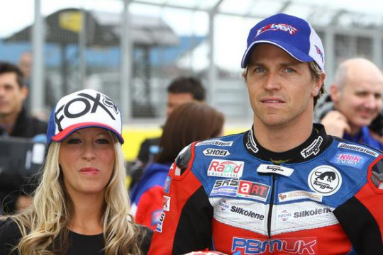 Ellison, pictured with wife Sarah, needs more pace on new rubber