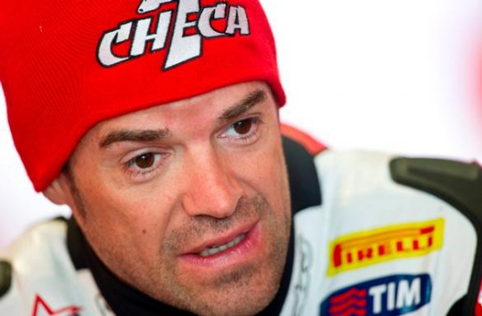 Carlos Checa vows to be back racing at Donington