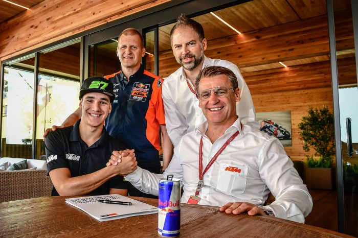 Lecuona with KTM's Pit Beirer (right), team boss Aki Ajo and a man whose haircut is 25 years too young for him