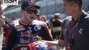 Bradl on the grid with a grumpy old man...