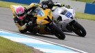 Ryde battling it out on track with Aussie rider Glenn Scott