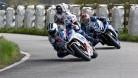Dunlop being pursued by Dan Kneen in the second Supersport race