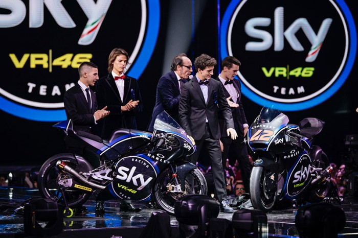 The riders alongside the Italian version of Dermot O'Leary. We think...